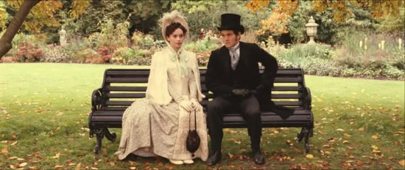 Mortimer and Emily sitting on a bench after he has proposed to her.