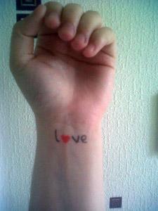 My wrist, with l♥ve written on it.
