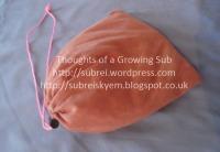 Pink drawstring bag.